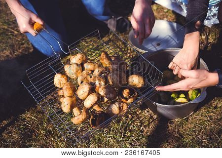 Mushrooms Of Brown Champignon Poribello Are Cooked On The Grill Or Barbecue, And Small Drops Of Wate