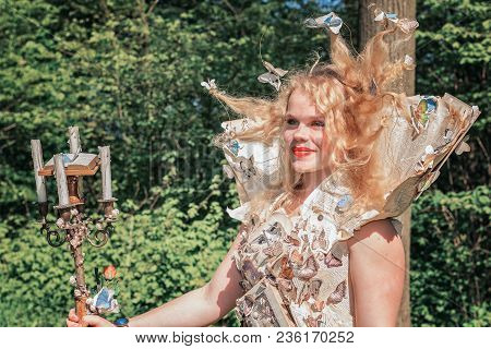 April, 19, 2014, Haarzuilens, The Netherlands: Beautifully Dressed Lady With A Paper Dress Decorated