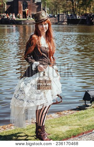 April, 19, 2014, Haarzuilens, The Netherlands: Beautiful Lady With Bird Cage Dressed In Steampunk St