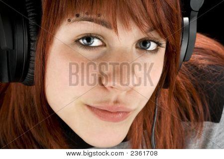 Seductive Girl Listening To Music