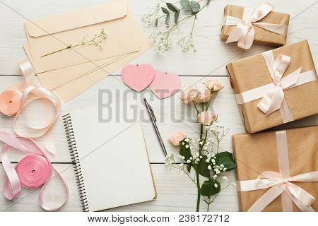 Wedding Background With Checklist. Paper Planner And Craft Envelopes On White Wooden Table With Lots