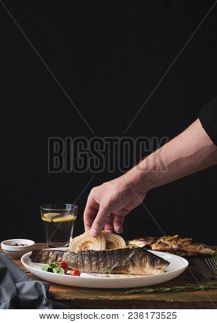 Restaurant Food - Chef Decorating Whole Grilled Sea Bass With Onion, Man Taking Seafood, Mediterrane