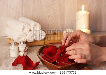 Female Hands Touch The Rose Petals, Preparation For The Spa Procedure For The Skin Of The Hands