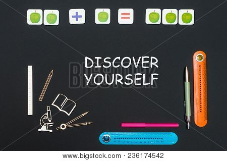 Concept Back To School, Above Stationery Supplies And Text Discover Yourself On Black Backboard