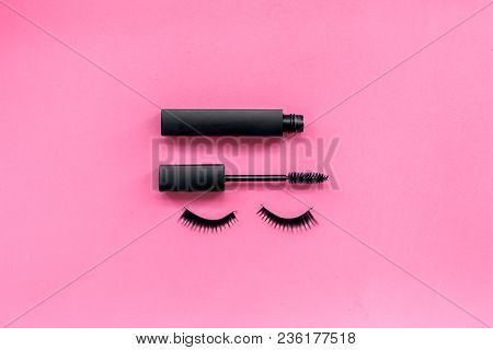 Basic Products For Eyelashes Makeup. Mascara And False Eyelashes On Pink Background Top View.