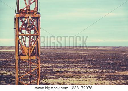 Retro Filtered Image Of Heavy Machinery At A Texas Oil Field With Copy Space