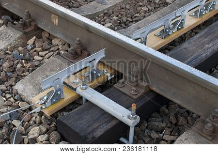 Control device of rolling stock on a dielectric beam poster