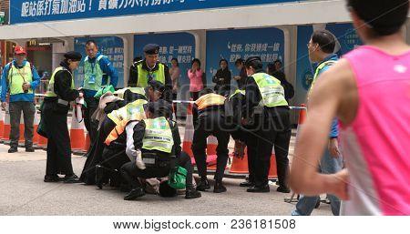 Causeway Bay, Hong Kong, 21 January 2018:- Unconscious athlete at the street during standard chartered marathon
