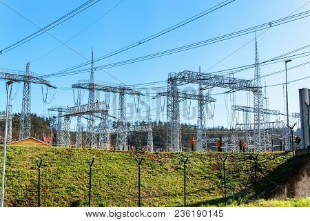 Production of electricity. Energy concept. Substation for high voltage conversion and distribution of electricity poster