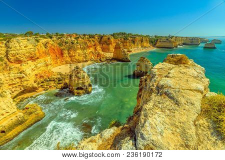 Aerial View Of High Cliff Of Praia Da Marinha In Algarve, Portugal, Europe. Scenic Landscape Of Mari