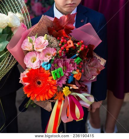 First Grade School Kids With Flowers Bouquet Celebrate Their First School Day Before Going To Classe