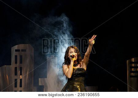 Woman Singer With Stylish Retro Hair And Makeup. Girl Sing In Microphone. Beauty And Vintage Fashion