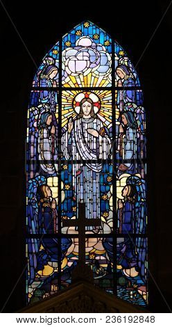 PARIS, FRANCE - JANUARY 07: Christ in glory, stained glass window in the Saint Laurent Church, Paris, France on January 07, 2018.