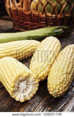 Sweet Corn On Sackcloth, Half Of Corn, Some Corn Peeled, Some Do Not,  Closeup