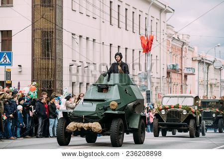Gomel, Belarus - May 9, 2017: Armoured Soviet Scout Car Ba-64 With Re-enactor Dressed As Russian Sov