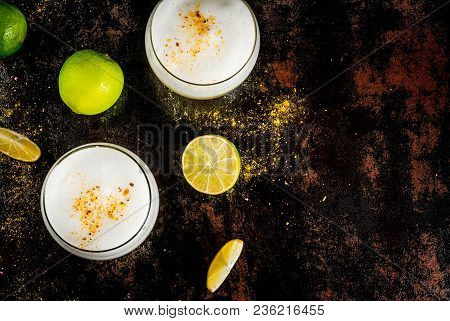 Peruvian, Mexican, Chilean Traditional Drink Pisco Sour Liqueur, With Fresh Lime, On Rusty Black Tab