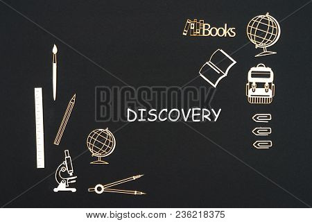 Concept back to school, text discovery with school supplies chipboard miniatures placed on blackboard poster