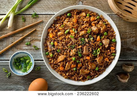 Delicious Pork Fried Rice With Egg, Carrot, Green Peas, Garlic And Green Onion.