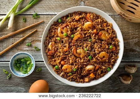 Delicious Shrimp Fried Rice With Egg, Carrot, Garlic, Green Peas And Scallions.