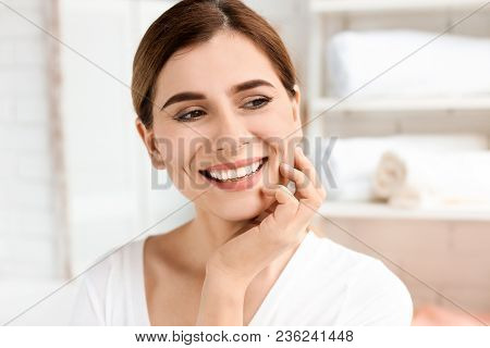 Young Woman With Beautiful Smile Indoors. Teeth Whitening