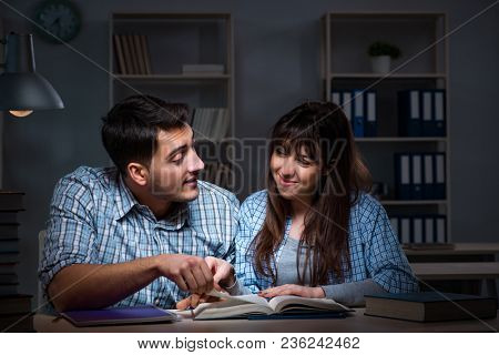 Two students studying late at night