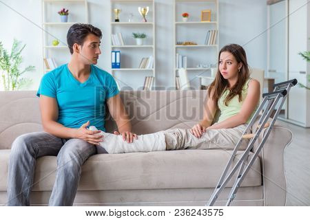 Husband man supporting injured wife