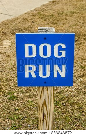Bright Blue And White Sign For A Dog Run