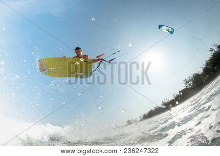 A kite surfer rides the waves