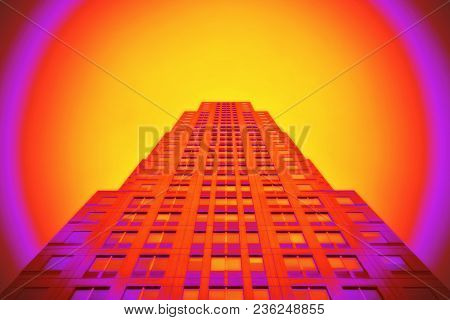 A ground view closeup of a modern skyscraper in a yellow, red and purple round aura.