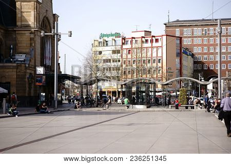Koblenz, Germany - April 08: Travelers And Passers-by Are Sitting At The Station Forecourt In Front