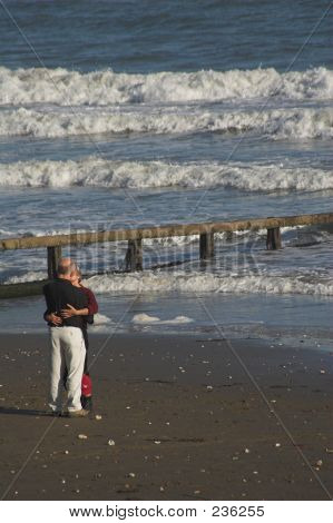 Mid Age Couple Kissing On Beach
