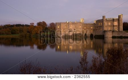 Old English Castle And Lake At Sunset