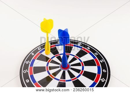 Dart Shot In The Bullseye On Dartboard On White Background, In Concept Of Opportunity And Competitio