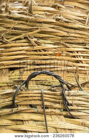 Stack Of Big Bamboo Basket Weave Surface Background In Nature Light
