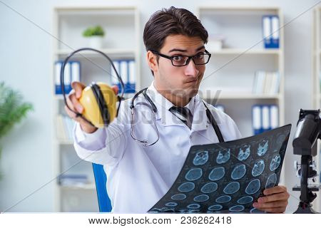Safety doctor advising about noise cancelling headphones
