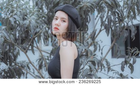 Portrait Beautiful Girl: Charming Girl Is Looking To Someone. Attractive Girl Looks So Confident And