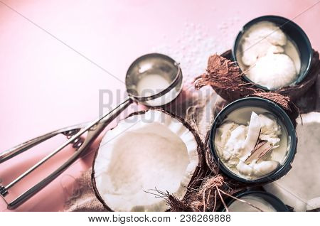 Natural Coconut Ice Cream On A Blue Background With A Spoon For Ice Cream, The Concept Of Summer And