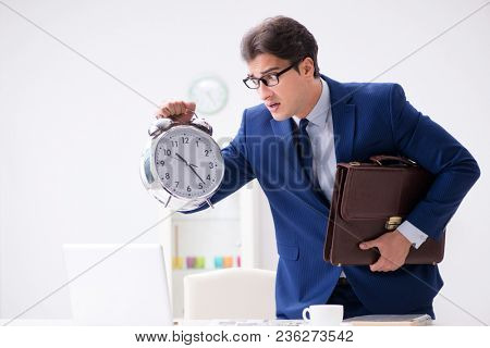 Businessman employee in urgency and deadline concept with alarm  poster
