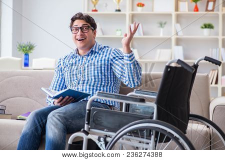 Young student on wheelchair in disability concept
