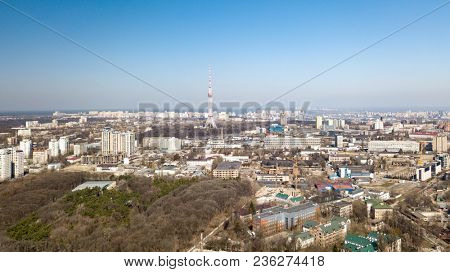 Panoramic view of the city with modern houses and a park, Dorogozhychi distric with a TV tower in the distance. Kiev, Ukraine. Drone photography from aerial view