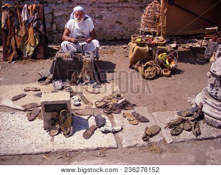 Selcuk, Turkey - June 18 2012 : Actor Posing As Old Artisan Shoe Maker In Ephesus Ancient City, Near