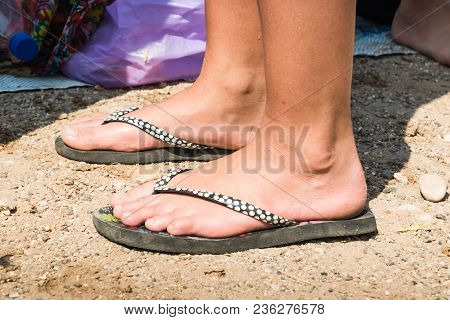 Feet On The Sand Of The Beach In A Summer Day