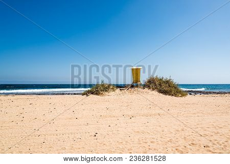 Scenic View Of Lifeguard Yellow Hut On The Beach Against Sky