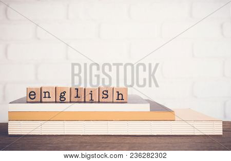 The Word English, Text On Wooden Cubes On Top Of Books. Background Copy Space, Vintage Minimal Style