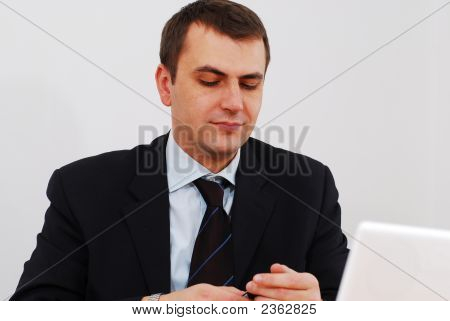 Successful Businessman Answering The Phone