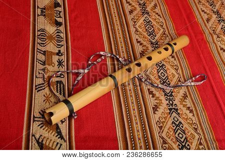 Andean flute from South America on a colorful textile