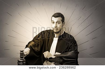 Young dashing judge in black gown making decision