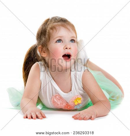 Portrait Of A Happy Child On A White Background. Enthusiastic Little Girl