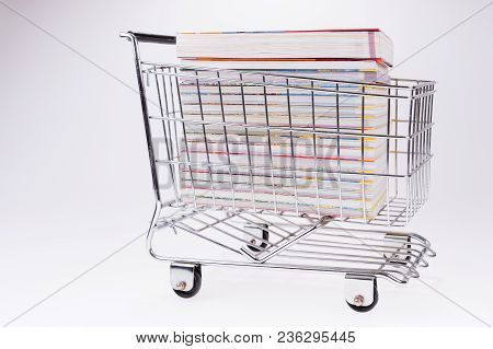 Shopping Cart Full Of Books. Online Orders Concept