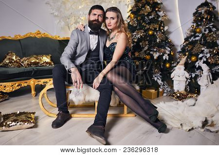 Lovely Couple In Love Near Christmas Tree On A New Year, Having A Rest On Christmas Holidays Before